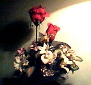 Flores artificiales (de papel o tela).