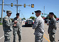 From left, U.S. Army Capt. David Jordan, a chaplain with Alpha Company, 1st Battalion, 279th Infantry Regiment, talks with Air Force Tech. Sgts 130522-Z-TK779-018.jpg
