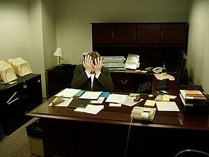 Frustration - A frustrated man sitting at a desk