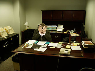 Frustration - A frustrated man sitting at a desk