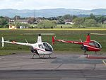G-JNSH With G-JKHT Two Robinsons R22 Helicopters (26616364044).jpg