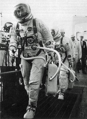 Gemini 3 - Astronauts John Young and Gus Grissom walk up the ramp leading to the elevator that will carry them to the spacecraft for the first manned Gemini mission