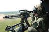 Ametralladora GAU-17 disparada desde UH-1N Huey en 2006.jpg