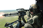 GAU-17 machine gun fired from UH-1N Huey in 2006.jpg