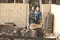 George W. Bush and Michael Brown view home damaged by wildfire.jpg