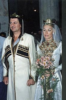 Dressed in georgian national wedding costumes celebrate their wedding
