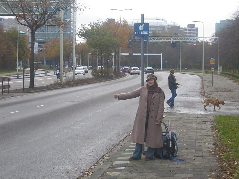 File:Girl-hitchhiking-at-liftershalte-in-Den-Haag.jpg