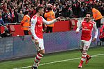 Giroud celebrates with Cazorla (15801576443).jpg