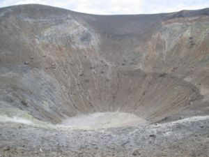 Vulcanian eruption -  The Gran Cratere, Vulcano.  A sense of scale is provided by the tourist visible near the centre of the crater.