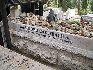 Bereavement in Judaism - The grave of rabbi-singer Shlomo Carlebach in Jerusalem is piled with stones left by visitors.