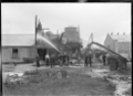 Group outside the fire damaged soap factory of Allender and Co, Petone ATLIB 141408.png