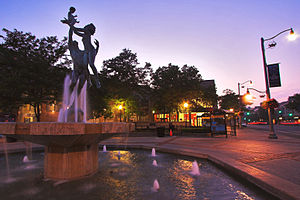 """Downtown Guelph - This statue entitled """"The Family"""" sits atop a fountain in the central square of Downtown Guelph"""
