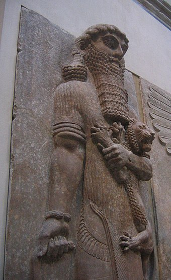 Ancient Assyrian statue currently in the Louvre, possibly representing Gilgamesh Herosmaitrisantunlion.jpg