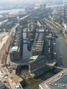 Aerial view of warehouses pervaded by loading canals and streets