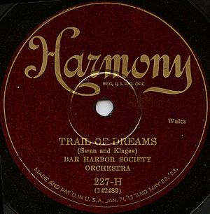 "Harmony Records - This 1926 disc featured ""Trail of Dreams"" by Einar Aaron Swan. The label kept its basic design until 1932 when the red background was brightened."
