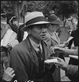 Hayward, California. Evacuees of Japanese ancestry about ready to board the bus to an Assembly cent . . . - NARA - 537504.tif