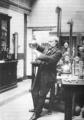 Heike Kamerlingh Onnes - 33 - James Dewar in the Royal Institution in London, around 1900.png