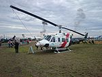 Heli-Serv (VH-JJR) Bell 212 Twin Huey on display at the 2015 Australian International Airshow 3.jpg