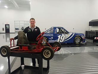 Daniel Hemric - Hemric stands with his first go-kart at the Brad Keselowski Racing shop in Statesville, NC