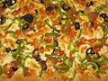 Homemade rectangular pizza in a black oven tray 08.jpg