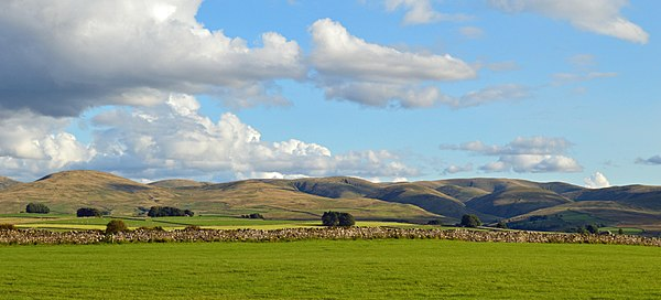 Panorama of Howgill Fells in evening from the hamlet of Raisbeck near Orton in the upper Lune valley
