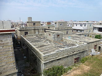 Hui'an County - Although apparently new, these houses inside Chongwu's city wall have been built in Hui'an's traditional style, using long narrow granite blocks for both the walls and the roof.