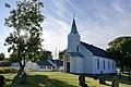 Hvasser kirke 1903 1908 Færder kommune, Norway 2020-07-02 White wooden church Kirkegård Churchyard Gravminner tombstones Summer Motlys backlight DSC01828.jpg