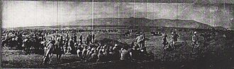 Capture of Afulah and Beisan - 6,000 Ottoman prisoners at Beisan receiving rations on 24 September with commander of 16th Division seated on right wearing white arm bands