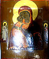 Icon of Madonna and Child and angel and Nikola (Dormition Church at Kondopoga).jpg