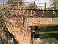 Identificação de patrimônio na cabeceira da ponte ferroviária (Ytuana) sobre o Ribeirão Piraí no limite dos municípios de Salto e Indaiatuba. Ao lado dela está a atual (Variante Boa Vista-Guaianã km 212) - panoramio.jpg