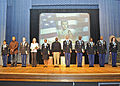 Induction recipients and spouses stand on stage, during a ceremony, at Sergeant Audie Murphy Club reenactment of Audie Murphy military biography, in Fort Gordon, Ga. 091212-A-NF756-005.jpg