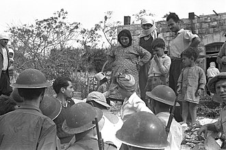 Iqrit - Villagers and IDF soldiers in Iqrit, 3 November 1948