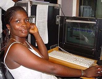 Atunda Ayenda - Isata Mahoi, shown editing radio programmes at Talking Drum Studio in Freetown; she is also an actress in the Sierra Leone radio soap opera, Atunda Ayenda