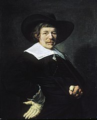 Portrait of a man with tassle collar and floppy hat
