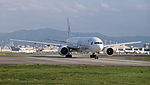 Japan Airlines Boeing 777-246ER JA708J Departing from Taipei Songshan Airport 20150102b.jpg