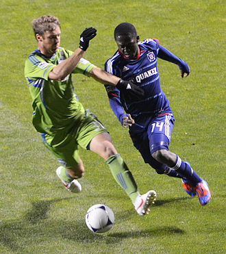 Jeff Parke - Jeff Parke of the Seattle Sounders is defending against attacking midfielder Patrick Nyarko of the Chicago Fire (Saturday, April 28, 2012)