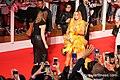Jennifer Lopez- Golden Yellow Dress (48699148101).jpg