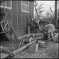 Jerome Relocation Center, Denson, Arkansas. Mrs. T. Arima busily prepares her doorstep garden in Bl . . . - NARA - 538835.jpg
