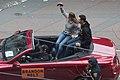 Jim Harbaugh drives Brandon Belt at 2012 World Series victory parade.jpg