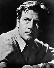 Joel McCrea, with his face partially in shadow