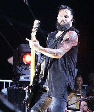 John Cooper (musician) - Cooper playing bass guitar in 2017