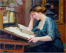 A woman looking at an open book