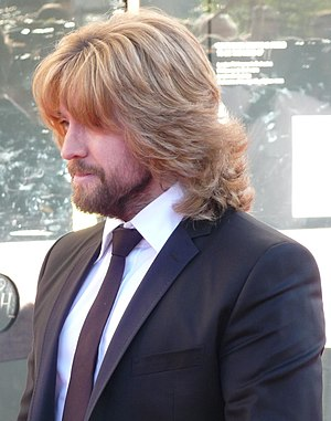 Justin Lee Collins on the red carpet at the BA...