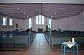 Kühlungsborn, Kath. Dreifaltigkeitskirche, Blick durch das Kirchenschiff auf den Altar.JPG