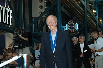 Gordon Cooper - Cooper at an induction ceremony of the U.S. Astronaut Hall of Fame in 2004. Astronauts John Young and Gene Cernan stand behind him.