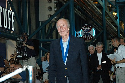 Cooper at an induction ceremony of the U.S. Astronaut Hall of Fame in 2004. Astronauts John Young and Gene Cernan stand behind him. KSC-04pd1006~orig.jpg