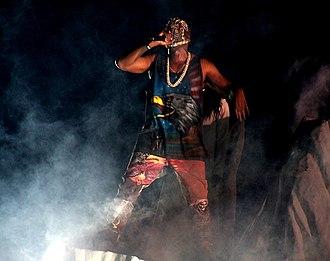 Maison Margiela - Kanye West wearing a mask and wardrobe by Maison Margiela on his 2013 Yeezus tour