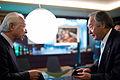 Kenji Fujiwara and Masashi Takehi exchange business cards (5261220127).jpg