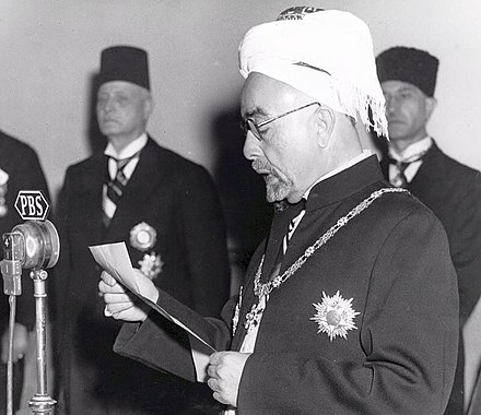 King Abdullah I on 25 May 1946 reading the declaration of independence. King Abdullah I of Jordan declaring independence, 25 May 1946.jpg