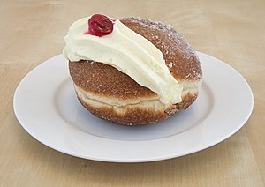 Berliner (doughnut) - The Kitchener bun is a Berliner cut on the side for the filling of jam and cream.